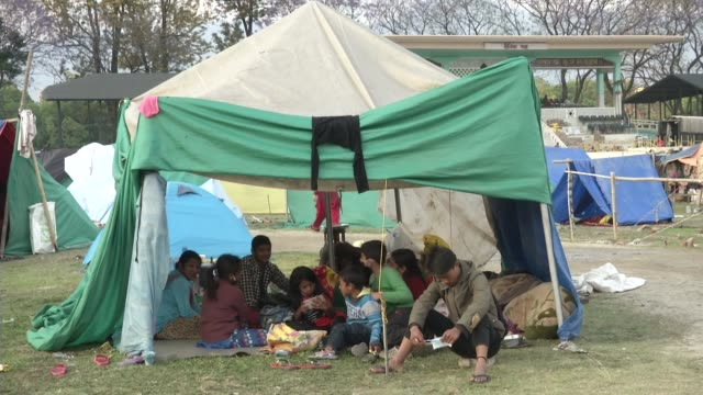Internally displaced people camp in Tundikhel in Kathmandu / A major earthquake hit Kathmandu midday on Saturday April 25th and was followed by...