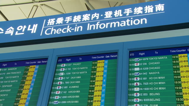 international airline flight information sign at airport - information sign stock videos & royalty-free footage