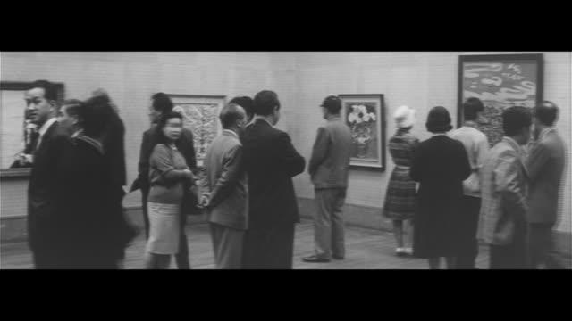 international art exhibition opens/japan international art exhibition preparations, opening day, people viewing the work, drawings - ausstellung stock-videos und b-roll-filmmaterial