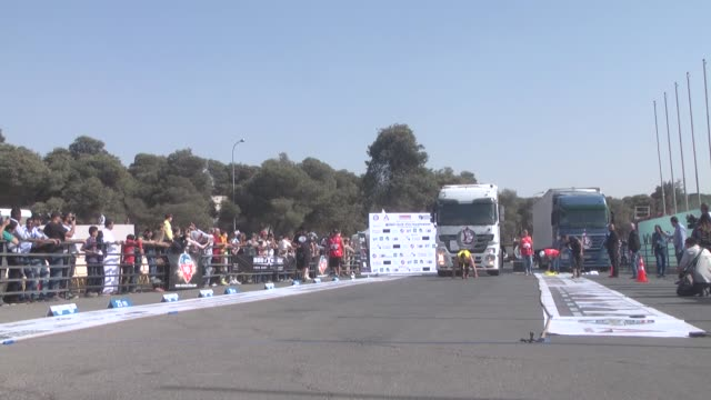 international athletes compete at the truckpull competion of the world's strongest man event taking place for the first time in the middle east on... - world's strongest man stock videos and b-roll footage