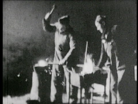 international brigade's motor workshop / building and repairing automobiles / blacksmithing and welding / trucks ready for the front - third reich stock videos and b-roll footage