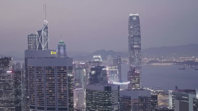 stockvideo's en b-roll-footage met international commerce centre and hong kong downtown city skyline at night. aerial drone view - hong kong