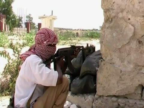 International Conference on Somalia held in London 2222012 GVs AlShabab fighters firing rifles from behind walls