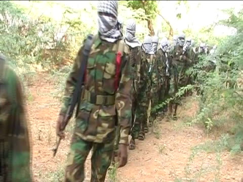 international conference on somalia held in london; tx 22.2.2012 al-shabab fighters in military uniform from forest with faces covered by scarves... - military uniform stock videos & royalty-free footage