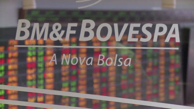 vídeos de stock e filmes b-roll de international credit ratings agency standard and poor's on thursday pushed brazil further into junk territory lowering the long term ratings of latin... - maior