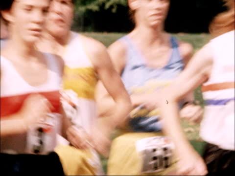 international female marathon race in london; england: london: battersea park: ext starter holds up gun / starter fires gun pull out mass of people... - battersea park stock videos & royalty-free footage