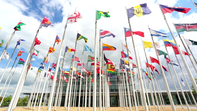 stockvideo's en b-roll-footage met international flags and office building - politiek
