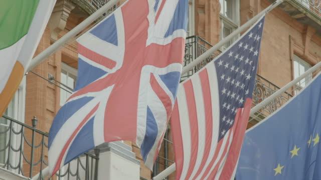ms international flags fly above entrance of claridge's hotel / london, united kingdom - claridge's stock videos & royalty-free footage