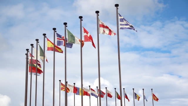 international flags on a background cloudy sky - national flag stock videos & royalty-free footage