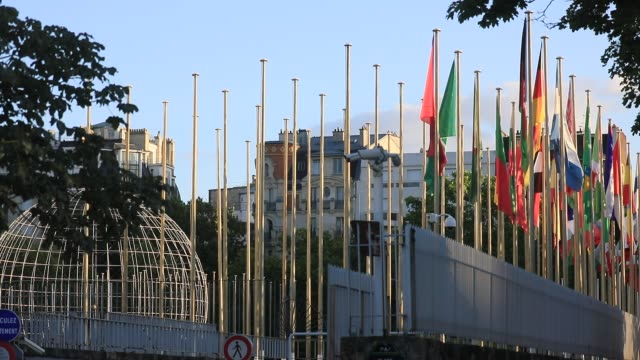 international flags wave in front of the unesco headquarters on july 6, 2020 in paris, france. the united nations educational, scientific... - sharing stock videos & royalty-free footage