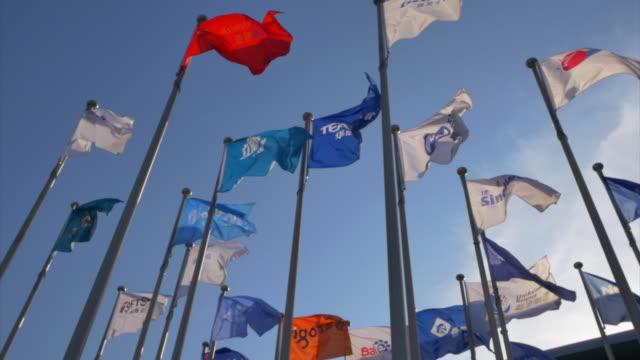 international flags wave in wind in blue clear sky. 4k