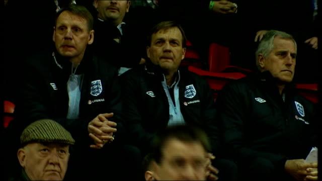vídeos y material grabado en eventos de stock de international friendlies; 28.2.2012 england: london: brisbane road: ext/night stuart pearce watching under 19s match england under 19s team on pitch... - number 9