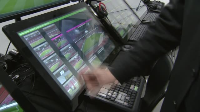 vidéos et rushes de england and germany draw / video referee used for first time in official game in uk int david elleray showing reporter video operation room where... - arbitre