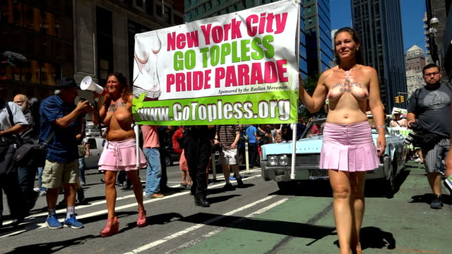 international go topless day pride parade / the participants marched from columbus circle 59th street in manhattan to downtown manhattan demanding... - semi dress stock videos & royalty-free footage