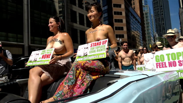 international go topless day pride parade / the participants marched from columbus circle 59th street in manhattan to downtown manhattan demanding... - around the fair n.y stock videos & royalty-free footage