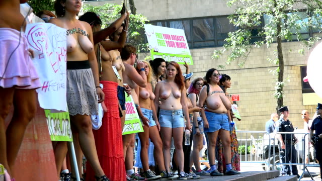 International Go Topless Day Pride Parade / The participants marched from Columbus Circle 59th Street in Manhattan to downtown Manhattan demanding...