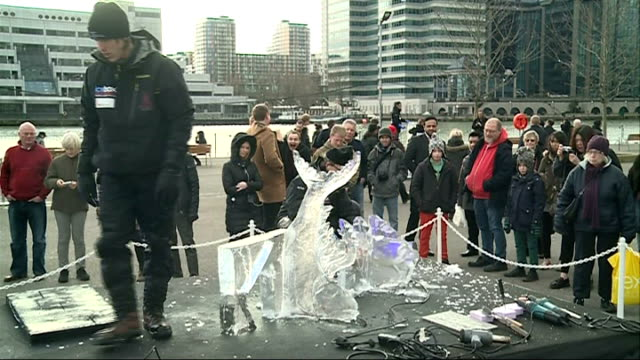 international ice sculpture festival 2014; **music heard intermittently sot** 'icework' / sculptor drilling into ice block / mime artist with balls... - mime artist stock videos & royalty-free footage