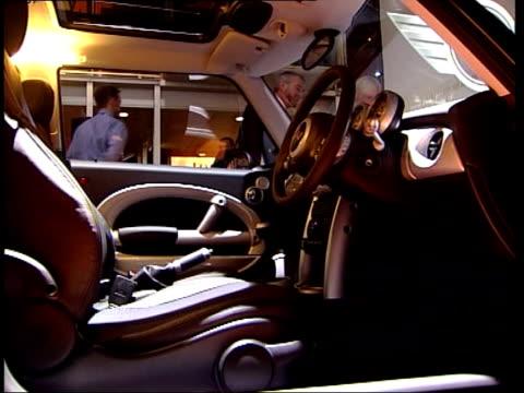 midlands birmingham gvs new mini cooper on display stand people looking at mini cooper gvs interior of mini gvs new jensen sports car uncovered gvs... - 自動車ブランド mini点の映像素材/bロール