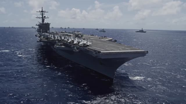 international navy ships and submarines transit the pacific ocean in close formation as part of the rim of the pacific exercise. - convoy stock videos & royalty-free footage