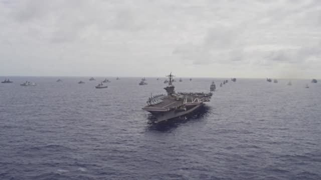 international navy ships and submarines transit the pacific ocean in close formation as part of the rim of the pacific exercise - warship stock videos & royalty-free footage