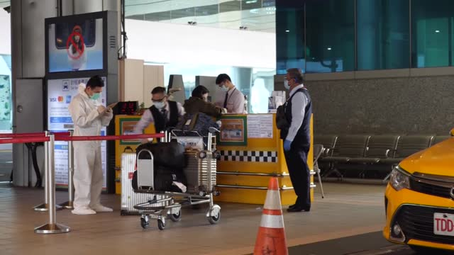 international passengers to taoyuan international airport fill out forms and along with luggage are disinfected before taking taxicabs into the city... - taipei stock videos & royalty-free footage