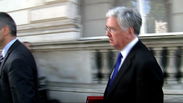 international plan to rescue thousands of refugees trapped on mount sinjar; england: london: ext michael fallon mp leaving downing street after... - sinjar mountains stock videos & royalty-free footage