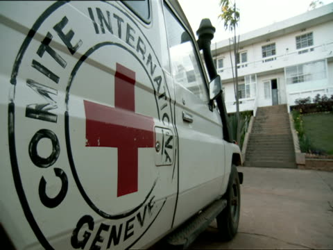 ms international red cross logo painted on side of ambulance / kigali, rwanda - logo stock videos and b-roll footage