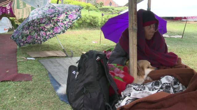 International rescue teams and relief supplies begin arriving in Nepals devastated capital to help terrified and homeless survivors of a quake that...