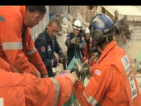 international rescue workers retrieve victim from rubble and pull her to safety following devastating earthquake haiti 17 january 2010 - haiti stock videos & royalty-free footage