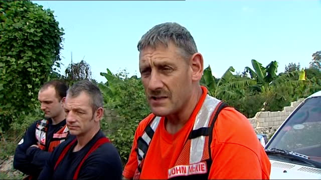 international rescuers in camp search and rescue teams along rescuers standing by buses marked 'un' reporter to camera john mckie interview sot... - haiti stock videos & royalty-free footage