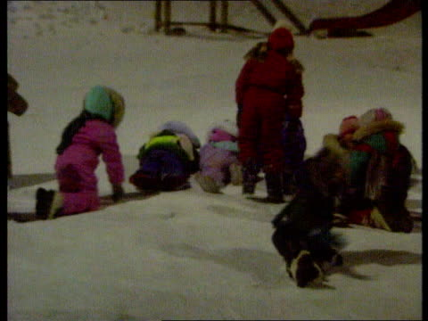 international research base spitzbergen dark but day ms well wrapped up children playing in snowing playground of kindergarten ms two small children... - 1990 stock videos & royalty-free footage