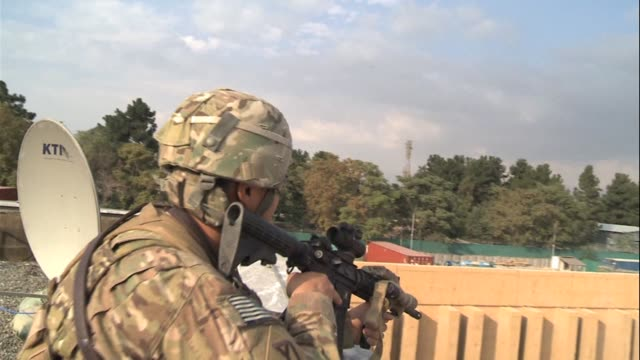 international security assistance force soldiers were on the frontline of bold taliban attacks on the us embassy and the headquarters of nato-led... - international security assistance force stock videos & royalty-free footage