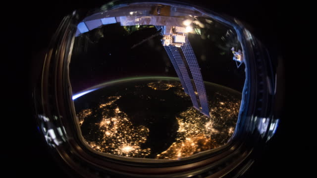 international space station (iss) porthole - razzo spaziale video stock e b–roll