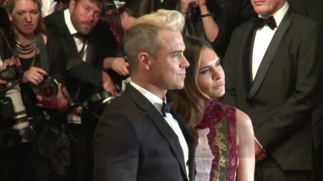 International stars like Robbie Williams Jane Fonda or Andie McDowell joined veteran American director Gus Van Sant's walk up the Red Carpet at...