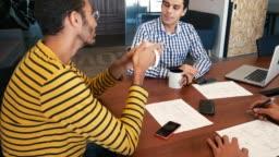 International teamwork in modern business - Hispanic business people on the meeting