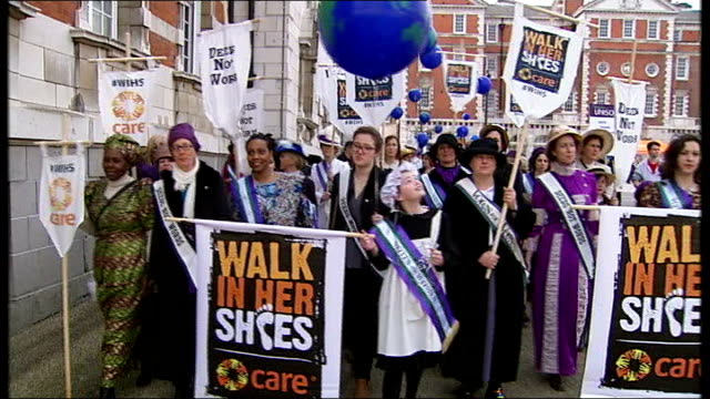 international women's day england london ext various of women marchers march along with 'deedsnot words' and 'walk in her shoes' banners as singing... - internationaler frauentag stock-videos und b-roll-filmmaterial