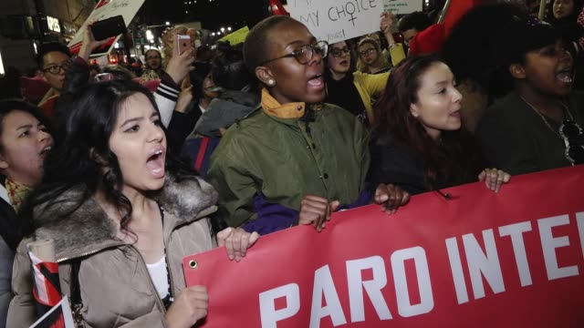 stockvideo's en b-roll-footage met international women's day march and strike / the rally began in washington square park and marched to the stone wall inn and ended in zuccotti park... - gelijkheid