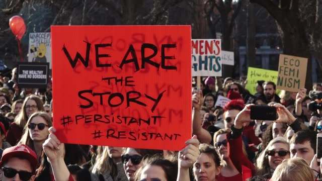 international women's day march and strike / the rally began in washington square park and marched to the stone wall inn and ended in zuccotti park... - marching stock videos & royalty-free footage