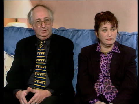 kilshaw couple appear on oprah winfrey show; lib england: chester: int alan kilshaw and judith kilshaw sitting on sofa during interview lib wales:... - 英国チェスター点の映像素材/bロール