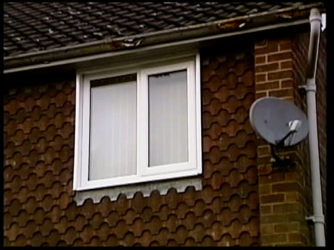 internet paedophile jailed itn merseyside gv beadle's home la windows of house tilt down to door shed in back garden zoom - merseyside stock videos and b-roll footage
