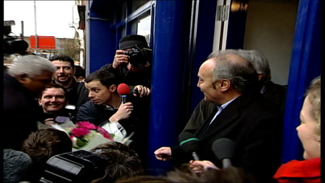 alleged links to hamas tx bethnal green george galloway mp speaking to press outside constituency offices man presents galloway with bunch of flowers... - bethnal green stock videos & royalty-free footage