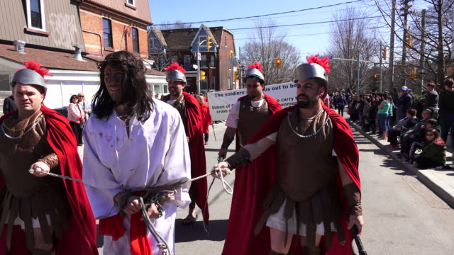 interpretation of roman soldiers pushing and beating jesus during the holy week procession. - holy week stock videos & royalty-free footage