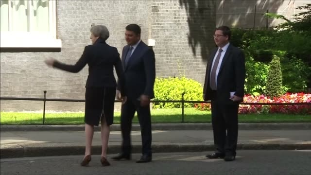 stockvideo's en b-roll-footage met interpreter for the prime minister arrested accused of spying for russia lib / 572017 london downing street ext prime minister theresa may mp... - vertaling