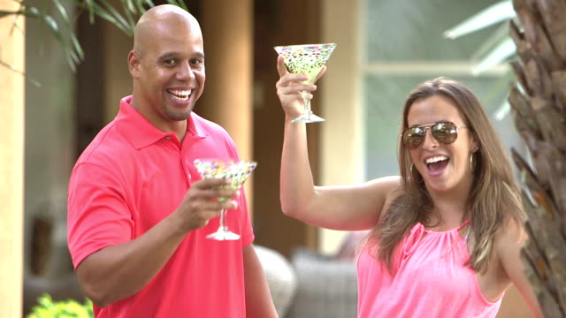 Interracial couple having fun, talking, drinking