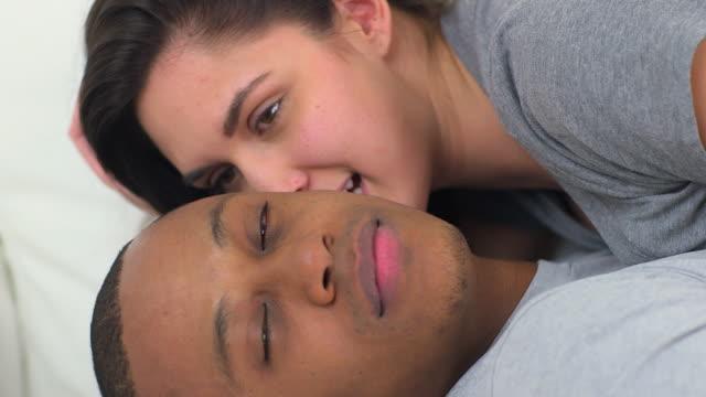 Interracial couple looking at camera