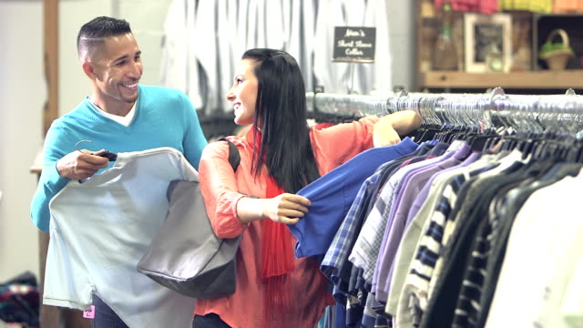 Interracial couple shopping in clothing store