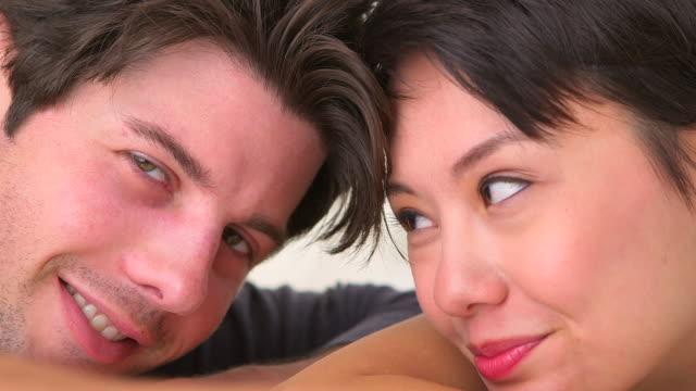 Interracial couple smiling