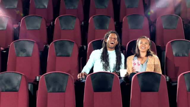 interracial couple watching movie in theater - pacific islander couple stock videos & royalty-free footage