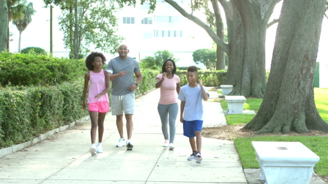 interracial family exercising in park, power walking - racewalking stock videos and b-roll footage