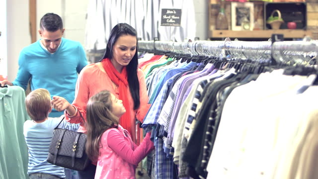 interracial family shopping for clothing - clothes shop stock videos & royalty-free footage